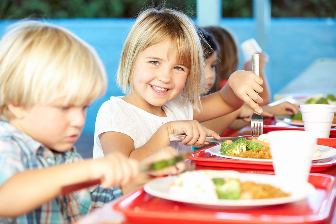 A child enjoying some food from our menu