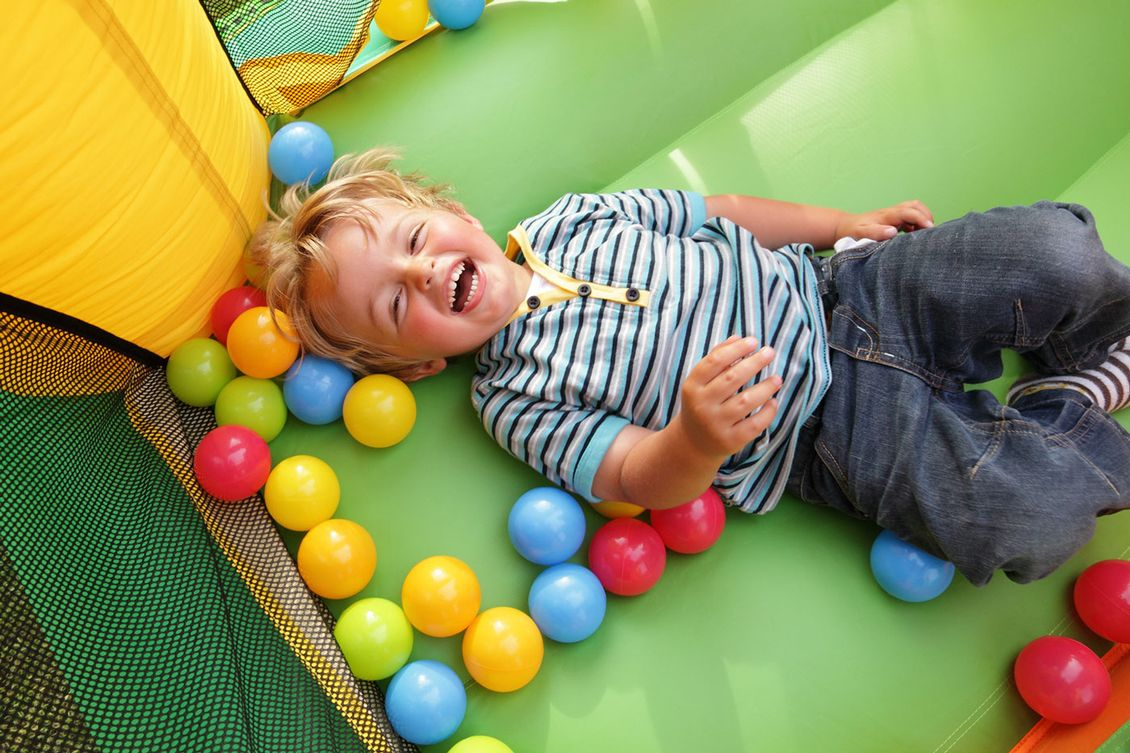 A child having fun playing in the ball pit
